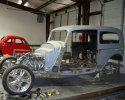 This is a shot of the car with the floor and wheel tubs removed and the new frame. It has a chrome independent front and rear suspension setup and ls1 drivetrain.